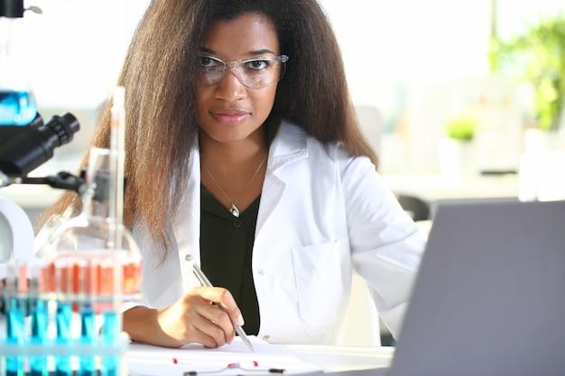 Black female chemist student conducting research