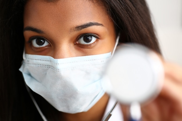 Black female doctor in a face mask
