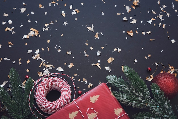 Black festive background with red and golden decoration