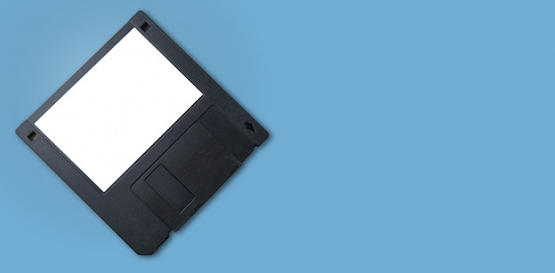 A black floppy disk with white label and blue