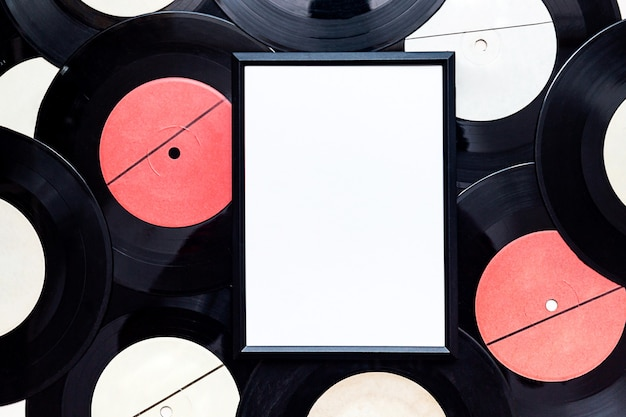 Black frame for photos on the of vinyl records.