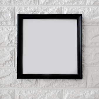 Black frame on white brick wall