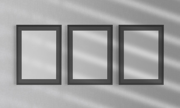 Black frames on a wall mockup 3d rendering