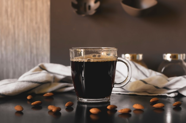 Black fresh coffee in a glass mug.