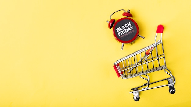 Black friday alarm clock above shopping cart