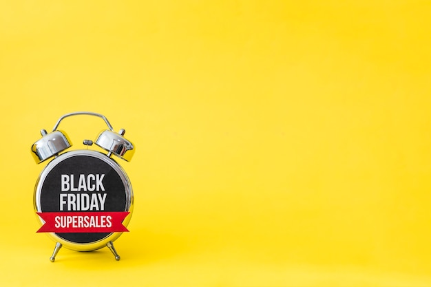 Black friday alarm on yellow background