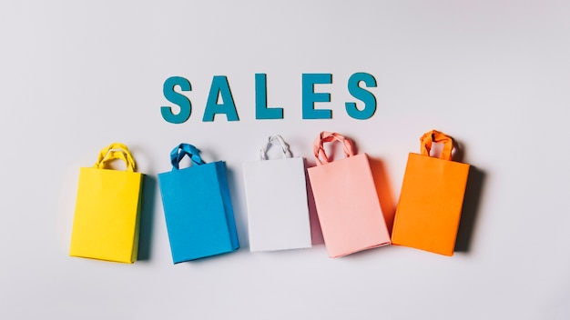 Black friday composition of five bags and letters Free Photo