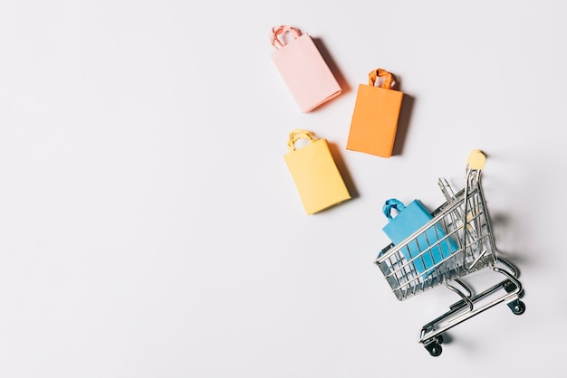 Black friday composition with four bags and cart