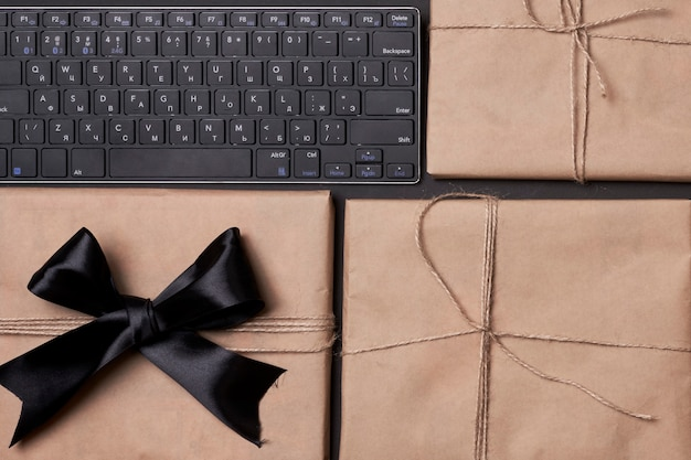 Black friday concept pile of giftboxes with computer keyboard