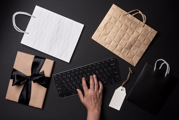 Black friday concept shopping online a person ordering gifts clothes and other items in online shop ...