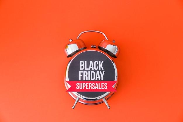 Black friday concept with alarm clock