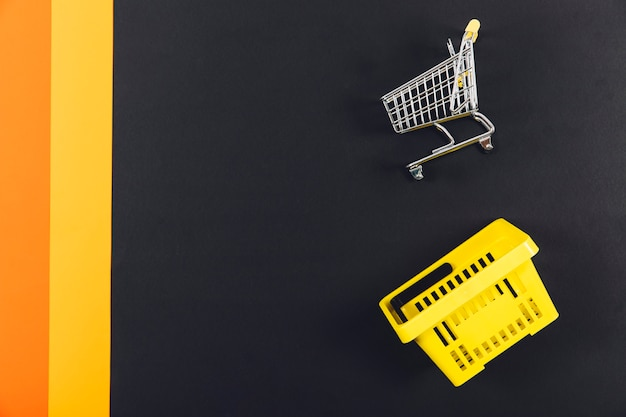 Black friday concept with cart and basket