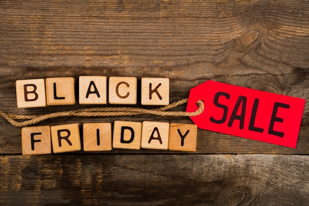 Black friday cubes and label on wooden background