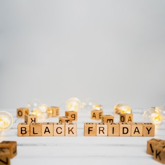 Black friday cubes on wooden table with copy space