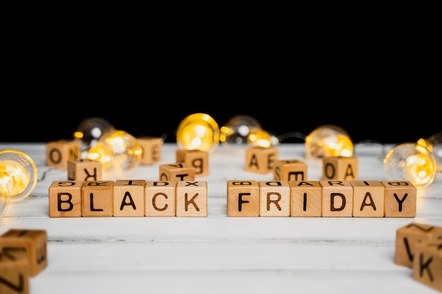Black friday cubes on wooden table