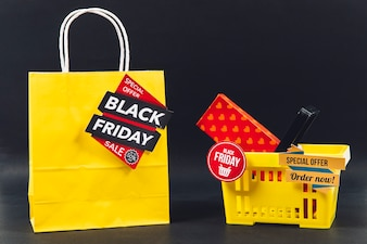 Black friday discount composition with bag and basket