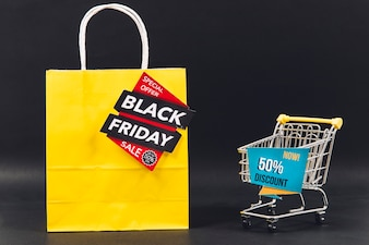 Black friday discount composition with bag and cart