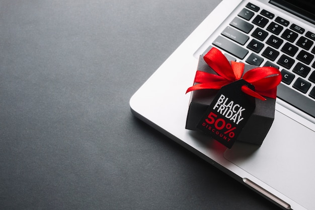 Black friday discount gift with red ribbon