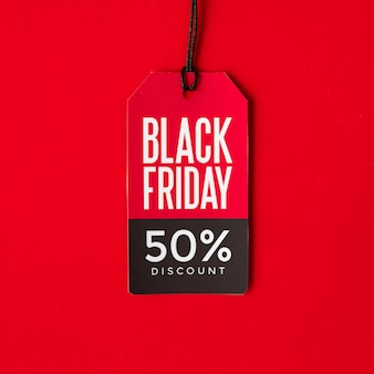Black friday discount tag on red background