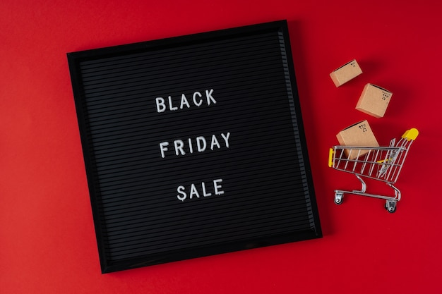 Black friday frame with shopping cart and boxes