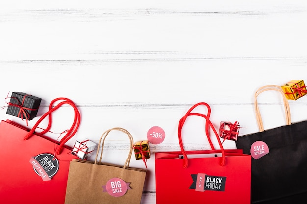 Black friday gift bags on wooden background