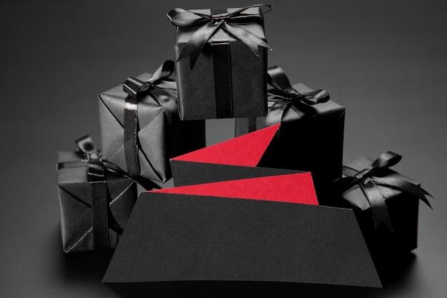 Black friday gifts on black background