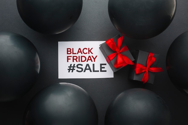 Black friday gifts surrounded by black balloons