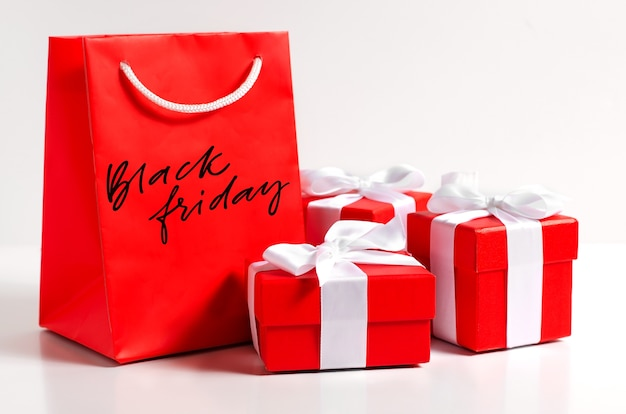 Black friday - handwritten inscription on a red gift bag.