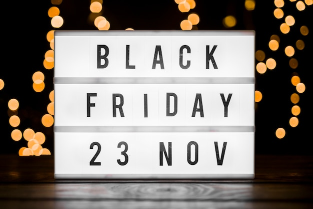 Black friday inscription on board with bokeh