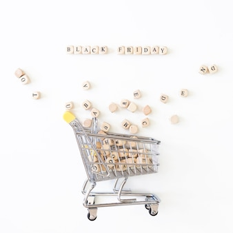 Black friday inscription on cubes with grocery cart