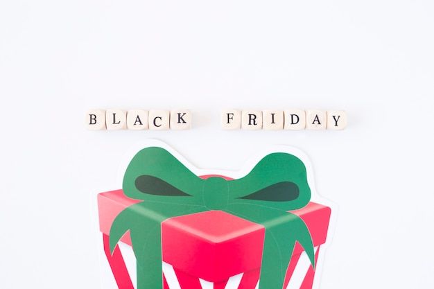 Black friday inscription on cubes with paper gift box