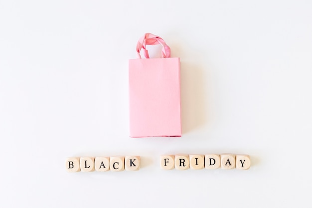 Black friday inscription on cubes with shopping bag