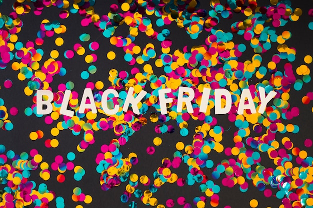 Black friday inscription from wooden letters with confetti