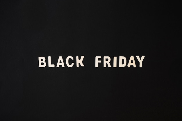 Black friday inscription from wooden table