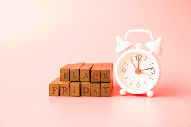 Black friday inscription near alarm clock