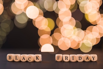 Black Friday inscription on cubes with bokeh