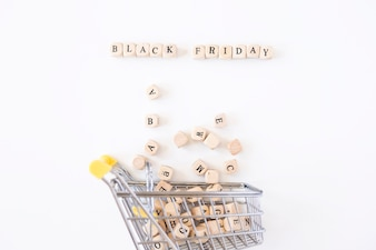 Black Friday inscription on cubes with small grocery cart