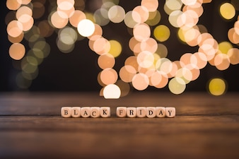 Black Friday inscription on small cubes with bokeh