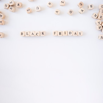 Black friday inscription on small cubes on white table