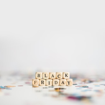 Black friday inscription on small white cubes