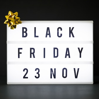 Black friday inscription on white board
