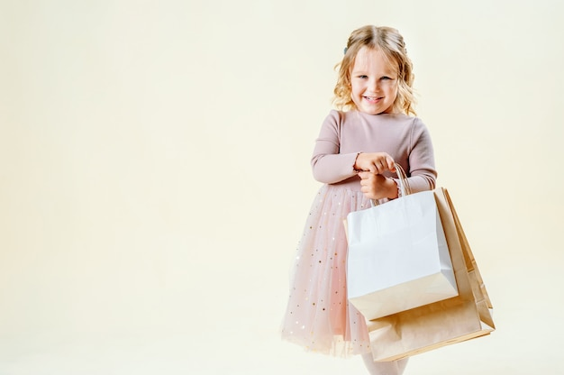 Black friday. little blonde girl holds craft packages