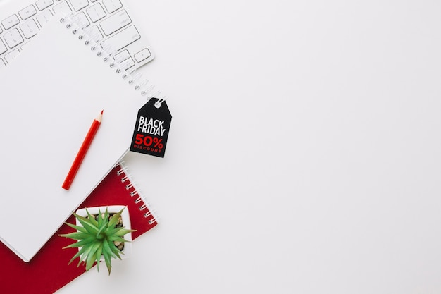 Black friday notepad with plant