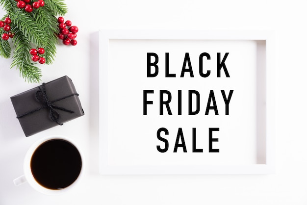 Black friday sale banner text on white picture frame decoration.