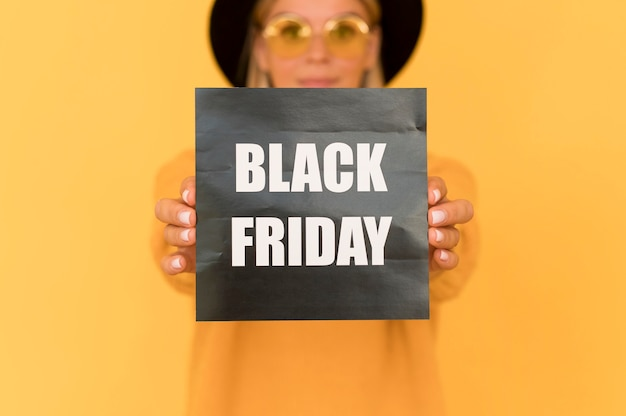 Black friday sale concept woman holding label