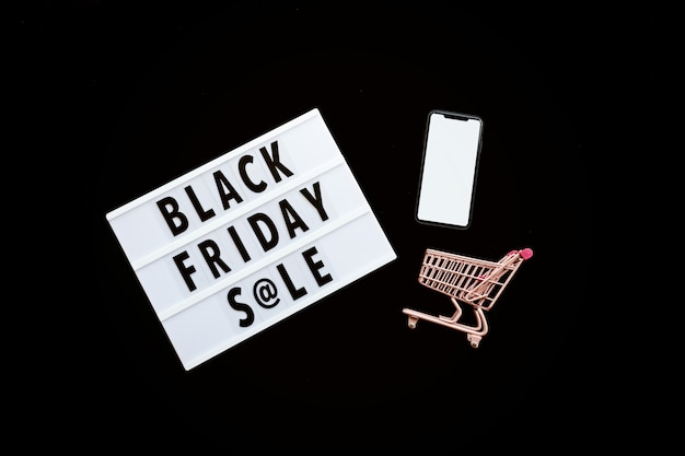 Black friday sale flat lay on black background