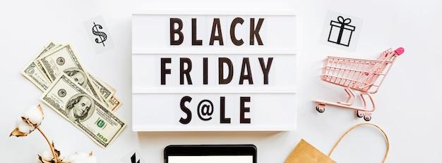 Black friday sale flat lay on white background