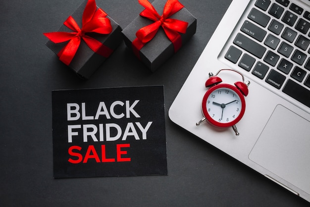 Black friday sale flat lay with alarm clock