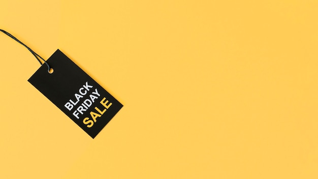 Black friday sale label on yellow copy space background