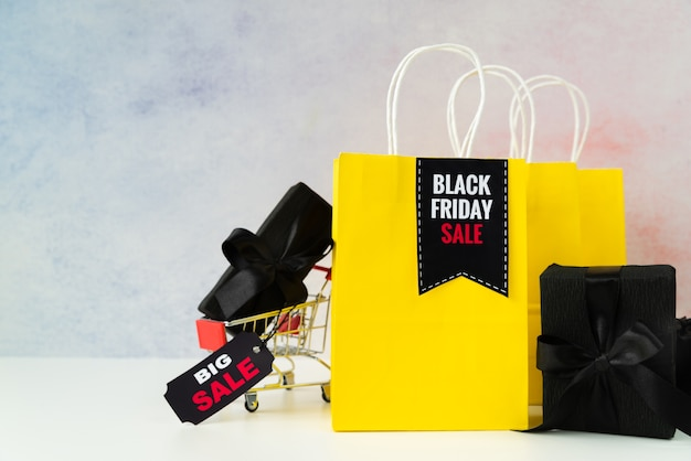 Black friday sale shopping bags with gifts